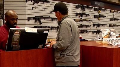 A man looks at firearms at the Poway Weapons & Gear Range in San Diego's North County.