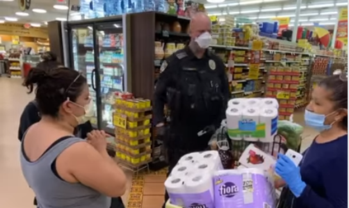 "An Escondido Police Department pays for a family's groceries as part of the department's ""Operation Zero Total"" initiative."