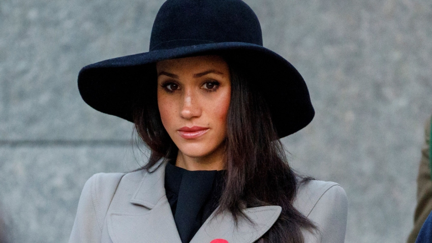 In this April 25, 2018, file photo, Meghan Markle, the US fiancee of Britain's Prince Harry, attends an Anzac Day dawn service at Hyde Park Corner in London, England.