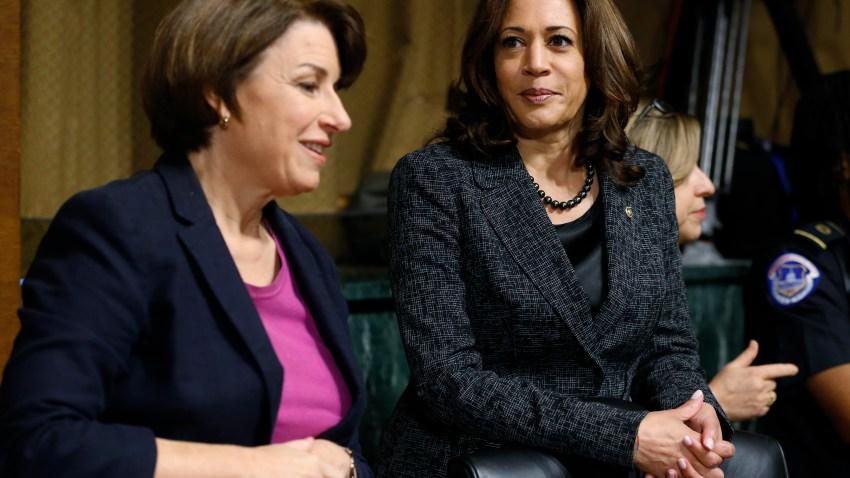 Senators Amy Klobuchar, D-Minn., left, and Kamala Harris, D-Calif., talk