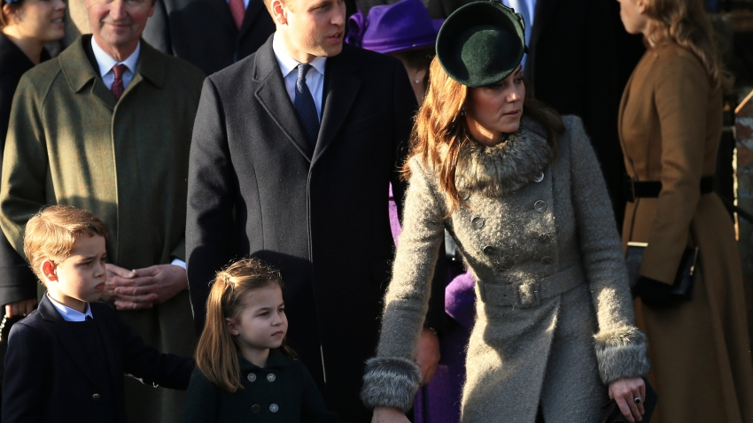 Britain's Prince William, Duke of Cambridge and Catherine, Duchess of Cambridge stand with their children Prince George and Princess Charlotte after attending a Christmas day service at the St Mary Magdalene Church in Sandringham in Norfolk, England, Wednesday, Dec. 25, 2019.
