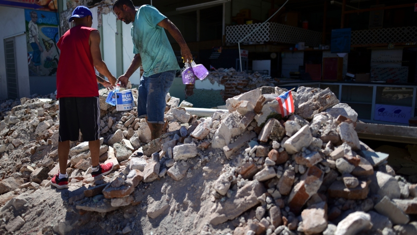 Store owners and family help remove supplies from Ely Mer Mar hardware store, which partially collapsed after an earthquake struck Guanica, Puerto Rico, Tuesday, Jan. 7, 2020. A 6.4-magnitude earthquake struck Puerto Rico before dawn on Tuesday, killing one man, injuring others and collapsing buildings in the southern part of the island.