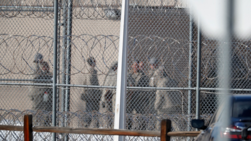 In this Feb. 18, 2020, file photo prisoners stand outside of the federal correctional institution in Englewood, Colo. Inmates at all 122 federal correctional facilities across the country will no longer be allowed visits from family, friends or attorneys for the next 30 days, in response to the threat of the coronavirus, officials told.