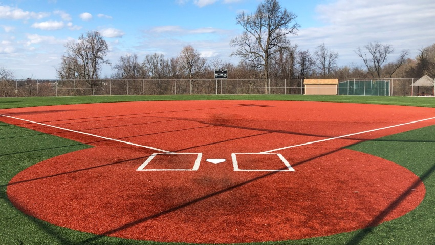 a youth baseball field sits empty at Monroeville Park in Monroeville, Pa.