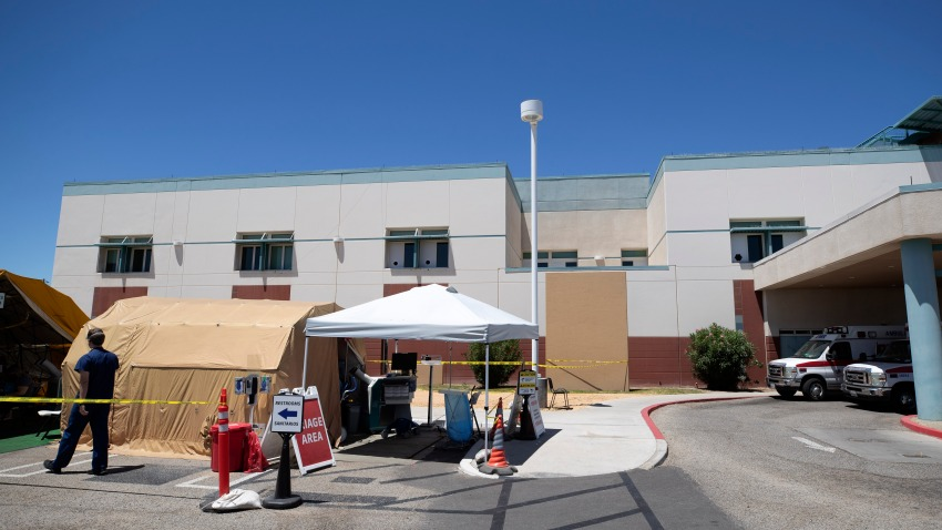 A tent sits in front of the El Centro Regional Medical Center to help process patients with symptoms related to the new coronavirus Wednesday, May 20, 2020, in El Centro, Calif.