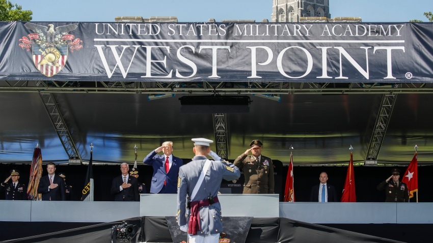 President Donald Trump, left, and United States Military Academy superintendent Darryl A. Williams, right, salute alongside graduating cadets at West Point