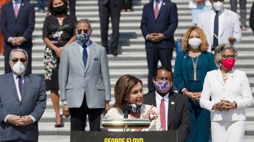 House Speaker Nancy Pelosi of Calif., joined by House Democrats spaced for social distancing, speaks during a news conference on the House East Front Steps on Capitol Hill in Washington, Thursday, June 25, 2020, ahead of the House vote on the George Floyd Justice in Policing Act of 2020.