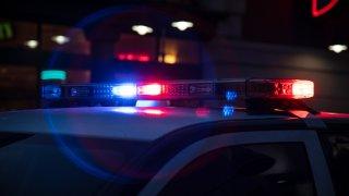 Police Lights Flashing on Dark Street