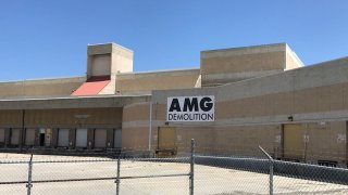 AMG Demolition sign at the old Midway Post Office