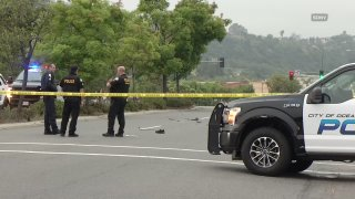 Oceanside police at the scene of a deadly car crash involving a pedestrian.