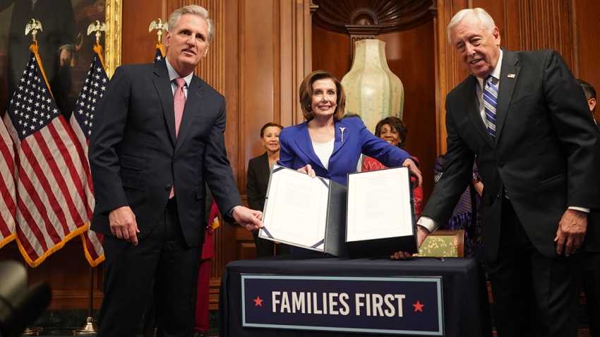 In this file photo, House Speaker Nancy Pelosi and Reps. Kevin McCarthy (left) and Steny Hoyer pose after signing a $2 trillion coronavirus relief bill, on March 27, 2020, at the Capitol in Washington, D.C.