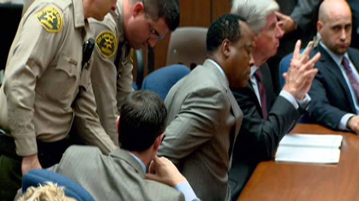 Conrad Murray handcuffs