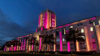 The San Diego County Administration building illuminated in honor of George Floyd.