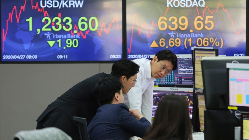In this April 27, 2020, file photo, currency traders watch monitors at the foreign exchange dealing room of the KEB Hana Bank headquarters in Seoul, South Korea.