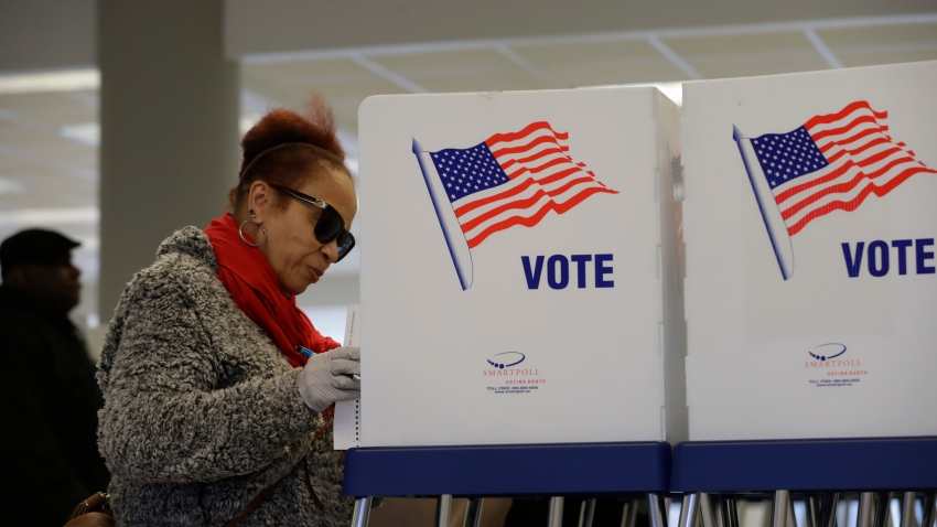 Andrea Anthory takes advantage of early voting, Friday, March 13, 2020, in Cleveland.