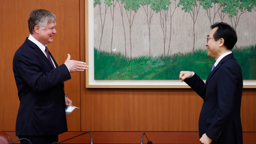 U.S. Deputy Secretary of State Stephen Biegun, left, is greeted by his South Korean counterpart Lee Do-hoon during their meeting at the Foreign Ministry in Seoul Wednesday, July 8, 2020. Biegun is in Seoul to hold talks with South Korean officials about allied cooperation on issues including North Korea.