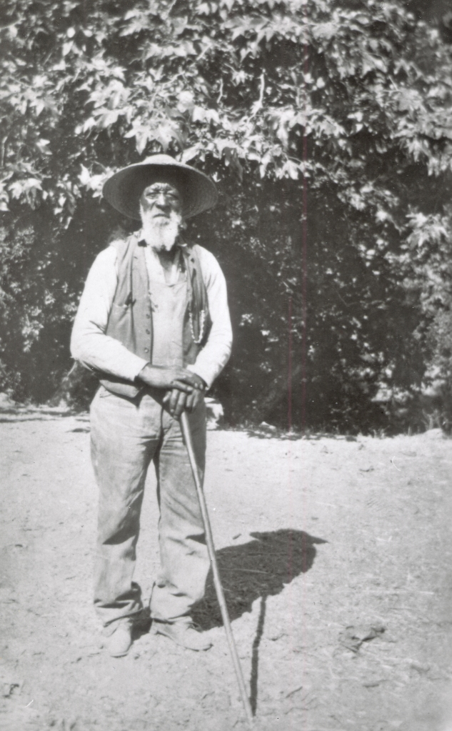 Harrison poses on his property in 1912.