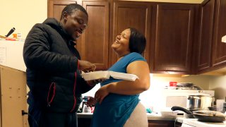 In this Thursday, Feb. 27, 2020, photo, Richard Butler and his fiance Amber laugh while they have breakfast in an apartment a friend is letting them live in on Chicago's Southside. Having food stamps offers Butler a stability he's rarely known in his 25 years. But that stability is being threatened for people like him, who are able-bodied, without dependents and between the ages 18 and 49.