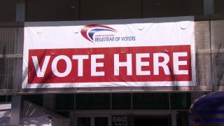 """A """"Vote Here"""" sign"""