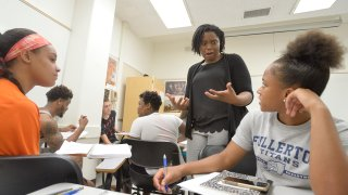 Professor Natalie Graham discusses how to ask non-leading questions with students at Cal State Fullerton