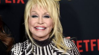"""In this Dec. 6, 2018, file photo, Dolly Parton arrives at the premiere of Netflix's """"Dumplin'"""" at the Chinese Theater in Los Angeles, California."""