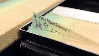 In this photo illustration U.S. Treasury checks are piled at the U.S. Treasury printing facility July 18, 2011 in Philadelphia, Pennsylvania.