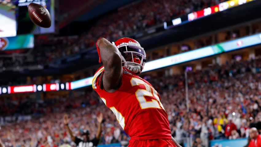 Damien Williams (26) of the Kansas City Chiefs runs for a touchdown against the San Francisco 49ers during the fourth quarter in Super Bowl LIV at Hard Rock Stadium on Feb. 2, 2020, in Miami, Florida.