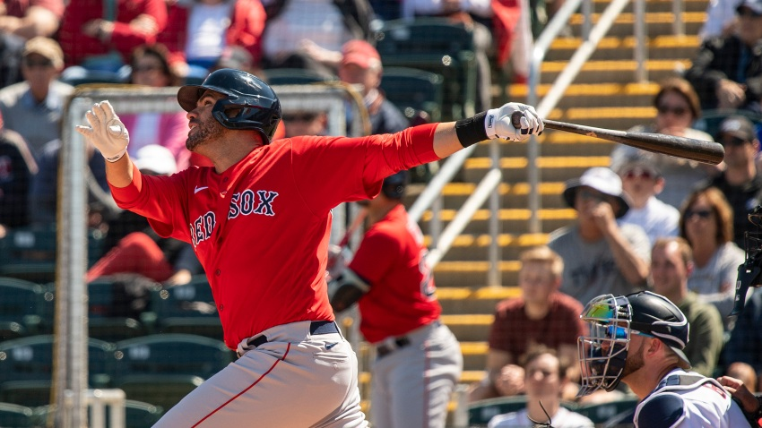 J.D. Martinez of the Boston Red Sox hits a triple during the first inning of a Grapefruit League game against the Minnesota Twins at CenturyLink Sports Complex on Feb. 28, 2020, in Fort Myers, Florida.
