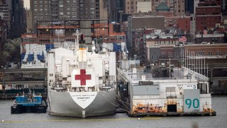 The USNS Comfort hospital ship is docked at Pier 90 in Manhattan on April 3, 2020 as seen from West New York, New Jersey.