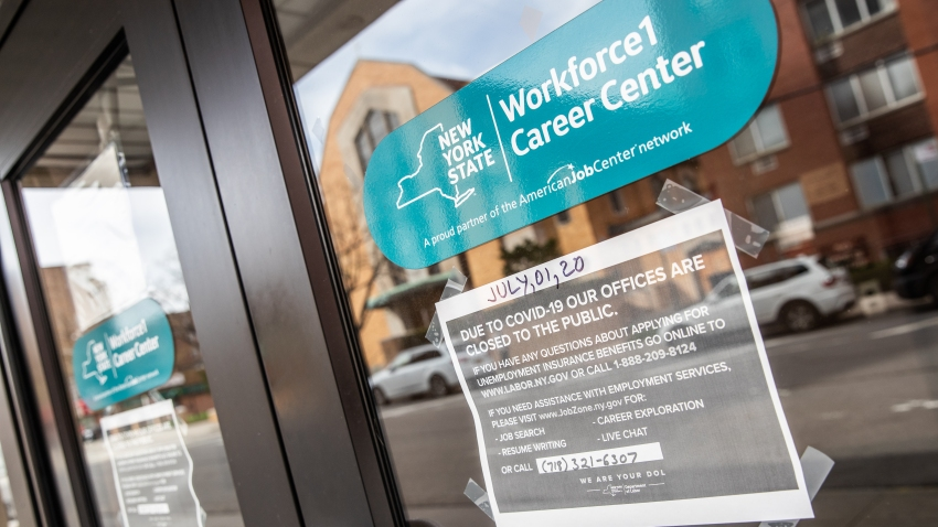 Signage is displayed on a closed New York State Department of Labor building