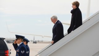 Vice President Mike Pence, center, walks off Air Force Two with Secretary of the Air Force Barbara Barrett at Peterson Air Force Base before Pence gives a graduation address at the Air Force Academy on April 18, 2020 in Colorado Springs, Colorado.