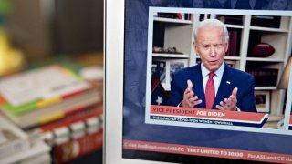 Former Vice President Joe Biden, presumptive Democratic presidential nominee, speaks during a virtual event seen on a laptop computer in Arlington, Virginia, U.S., on Tuesday, April 28, 2020.