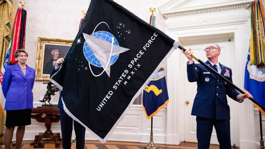 In this May 15, 2020, file photo, Chief Master Sgt. Roger Towberman (R), Space Force and Command Senior Enlisted Leader and CMSgt Roger Towberman (L), with Secretary of the Air Force Barbara Barrett present President Donald Trump with the official flag of the United States Space Force in the Oval Office of the White House in Washington, DC.
