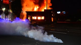 A Wendys restaurant burns after protesters allegedly set it on fire on June 13, 2020 in Atlanta, Georgia. Fresh protests rose up after an Atlanta police officer shot and killed Rayshard Brooks, an unarmed African American man outside the restaurant. .