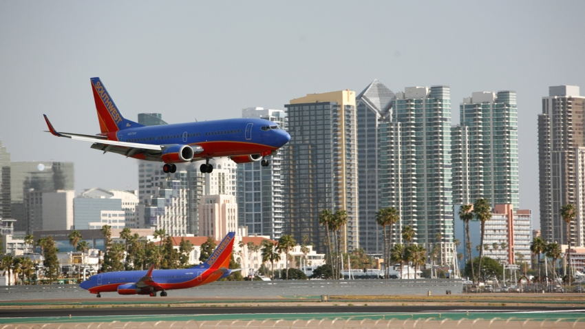 A plane lands at San Diego International Airport