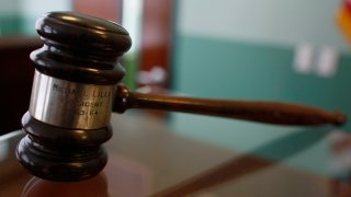 In this Feb. 3, 2009, file photo, a judges gavel rests on top of a desk in the courtroom of the Black Police Precinct and Courthouse Museum in Miami, Florida.