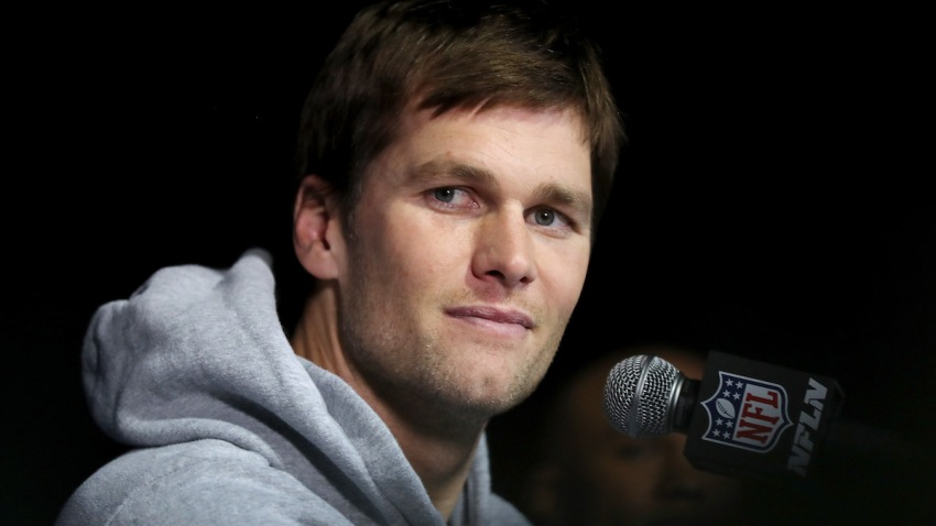 In this file photo, Tom Brady of the New England Patriots answers questions during a media availability for Super Bowl LII at the Mall of America on January 30, 2018 in Bloomington, Minnesota.