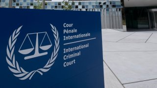 Exterior of the International Criminal Court building is seen with sign in front