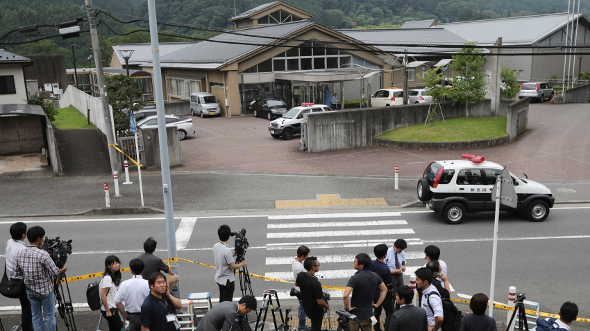 In this July 26, 2016, file photo, journalists gather in front of Tsukui Yamayuri-en, a facility for the handicapped where a former care home employee killed disabled people, in Sagamihara, outside Tokyo. The Yokohama District Court sentenced Satoshi Uematsu, 30, to death Monday, March 16, 2020, for killing 19 disabled people and injuring 24 others four years ago in the deadliest mass attack in postwar Japan.