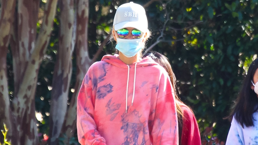 In this April 3, 2020, file photo, Laeticia Hallyday walks her dogs in Los Angeles, California.