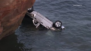 A man and his two young daughters were rescued after he intentionally drove off Sunset Cliffs.