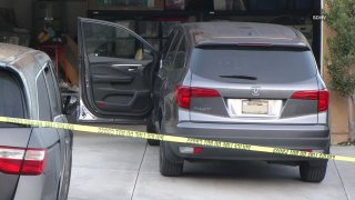 Photo of the two cars that pinned the man