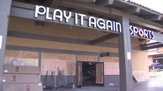 A Play it Again Sports store in the La Mesa Springs Shopping Center days after looters and rioters ransacked its shelves and set fires inside.