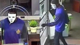 Masked Suspect in Bank Robbery