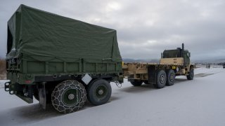 A U.S. Marine Corps Medium Tactical Vehicle Replacement from the MCPP-N caves sits staged at Vӕrnes Garnison, Norway.