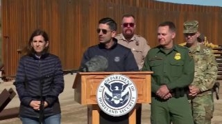 Acting Department of Homeland Security Chad Wolf speaks in front of the southern border wall.