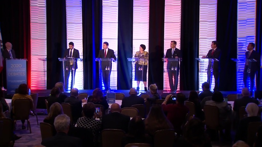 Candidates on debate stage.