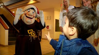 The San Diego Padres mascot greets a kid at Rady Children's Hospital