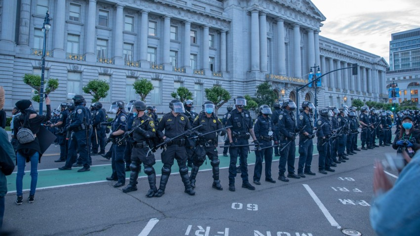 Police are seen during a protest against the death in Minneapolis police custody of African-American man George Floyd at San Francisco City Hall.