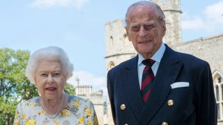 Britain's Queen Elizabeth II and Prince Philip the Duke of Edinburgh pose for a photo June 1, 2020, in the quadrangle of Windsor Castle, in Windsor, England, ahead of his 99th birthday on Wednesday, June 10.